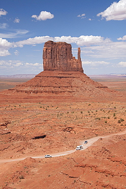 Monument Valley Navajo Tribal Park, Park Road (foreground), West Mitten (background), Utah, United States of America, North America