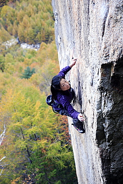 A woman rock climbing at Ogawayama, a mountain on the border of Nagano and Yamanashi prefectures, Honshu, Japan, Asia