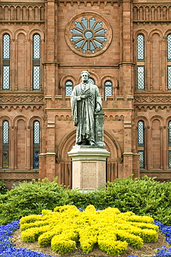 Entrance to the Smithsonian Castle with statue of Joseph Henry outside on the Mall in Washington, D.C., United States of America, North America