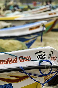 Brightly coloured fishing boats at the port of Negombo, Sri Lanka, Asia