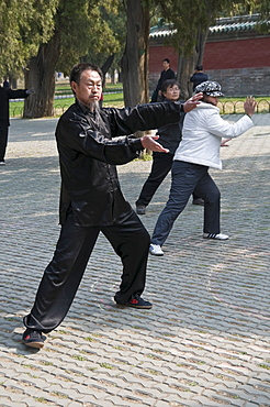 Local people take part in a Tai Chi session in the Temple of Heaven park in Beijing, China, Asia