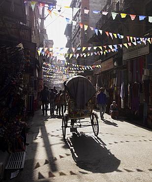 A rickshaw driving through the streets of Kathmandu, Nepal, Asia