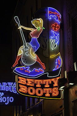 Neon signs and historic music clubs along Lower Broadway in Nashville, Tennessee, United States of America, North America