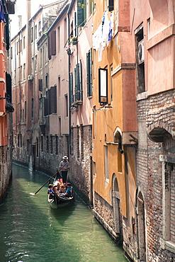 Gondola with tourists on a narrow canal, Venice, UNESCO World Heritage Site, Veneto, Italy, Europe