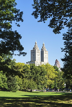Central Park with the San Remo Building beyond the trees, Manhattan, New York City, New York, United States of America, North America