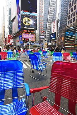 Garden chairs in the road for the public to sit in the pedestrian zone of Times Square, Manhattan, New York City, New York, United States of America, North America