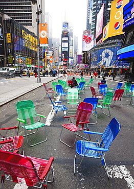 Garden chairs in the road for the public to sit and relax in the pedestrian zone, Times Square, New York City, New York, United States of America, North America