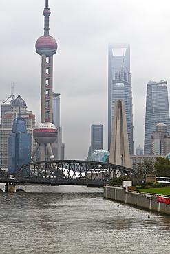 Suzhou Creek and the Waibaidu Bridge with view towards the Pudong skyline, Shanghai, China, Asia