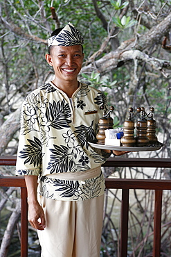 Indonesian waiter at the Banyan Tree hotel, Bintan, Indonesia, Southeast Asia, Asia