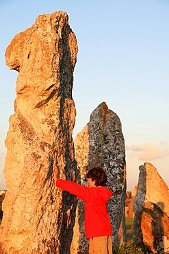 Boy with menhir, Camaret-sur-Mer, Finistere, Brittany, France, Europe