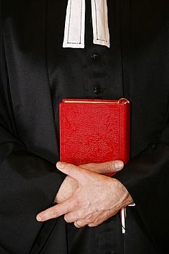 Protestant minister holding Bible, Paris, Ile de France, France, Europe