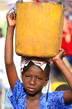 Girl carrying a heavy load, St. Louis, Senegal, West Africa, Africa