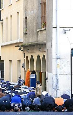 End of Ramadan prayers outside a mosque, Paris, France, Europe