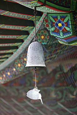 The fish-shaped chime on the Buddhist wind bell, honors those creatures which never close their eyes, Seoul, South Korea, Asia