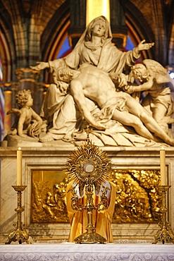 Eucharist adoration in Notre Dame de Paris cathedral, Paris, France, Europe