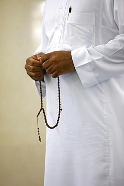 Muslim with prayer beads, Jumeirah mosque, Dubai, United Arab Emirates, Middle East
