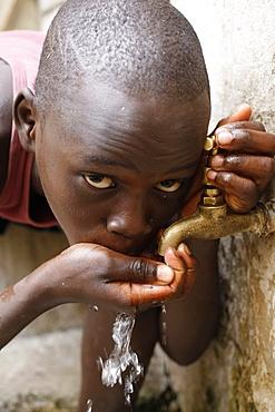 Boy drinking water, Dakar, Senegal, West Africa, Africa