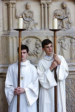 Altar boys outside Notre Dame de Paris Cathedral, Paris, France, Europe