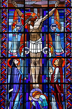 Stained glass of the Crucifixion in Notre Dame du Rosaire Catholic church, Saint-Ouen, Seine-Saint-Denis, France, Europe