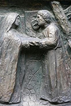 Sculpture of Jesus meeing his mother on the Via Dolorosa on the Notre Dame door, Saint-Pierre de Montmartre church, Paris, France, Europe
