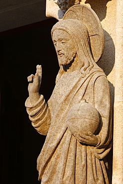 Western gate sculpture of the risen Christ holding the world, Saint-Corentin Cathedral, Quimper, Finistere, Brittany, France, Europe