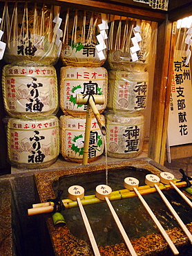 Ablution ladles at the entrance of a Shinto shrine, Kyoto, Japan, Asia