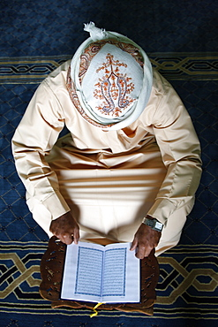 Koran reading in a mosque, Dubai, United Arab Emirates, Middle East