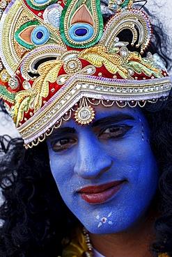 Man impersonating Hindu god Krishna at Janmashtami festival at Bhaktivedanta Manor ISKCON (Hare Krishna) temple, Watford, Hertfordshire, England, United Kingdom, Europe