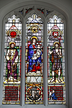 Stained glass window by Lawrence Lee showing the Virgin Mary and Child flanked by St. Thomas and St. John the Baptist with a roundel of the church tower and kneeling figure of Christopher Wren below, South Chapel, St. Mary Aldermary Church, City of London, London, England, United Kingdom, Europe