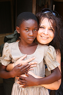 Sponsor and child in a primary school in Africa, Lome, Togo, West Africa, Africa