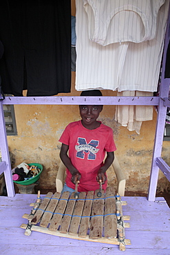 African boy playing music, Lome, Togo, West Africa, Africa