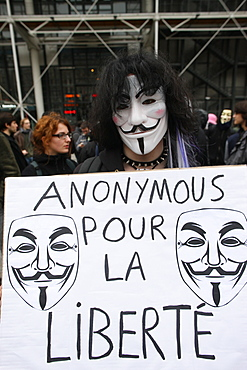 Protestor wearing Guy Fawkes mask, trademark of the Anonymous movement and based on a character in the film V for Vendetta, Paris, France, Europe