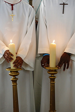 Catholic altar boys holding church candles, Seine-Saint-Denis, France, Europe