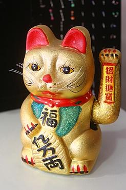 The Maneki-neko (Welcoming Cat) (Lucky Cat) (Money Cat) (Fortune Cat), a Chinese symbol in Seine-et-Marne, France, Europe