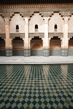 Columned arcades in the central courtyard of the Ben Youssef Medersa, the largest Medersa in Morocco, originally a religious school founded under Abou el Hassan, UNESCO World Heritage Site, Marrakech, Morocco, North Africa, Africa