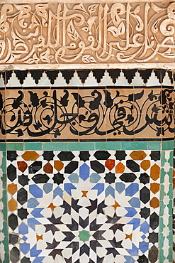 Detail of calligraphy and zellij in the patio, Ben Youssef Meders, the largest Medersa in Morocco, originally a religious school founded under Abou el Hassan, UNESCO World Heritage Site, Marrakech, Morocco, North Africa