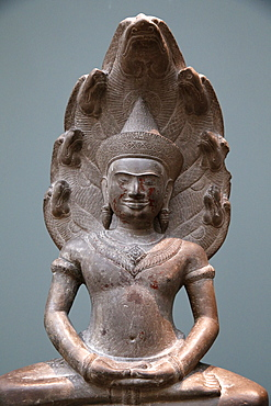 Buddha protected by the Naga, Musee Guimet, Museum of Asian Arts. Paris, France, Europe