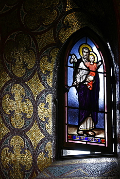 Stained glass window in the crypt of the Immaculate Conception Basilica, Lourdes, Hautes Pyrenees, France, Europe