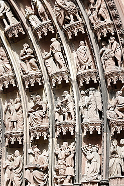 Scenes from the Old and New Testaments on the arches of the western front of Our Lady of Strasbourg Cathedral, Strasbourg, Alsace, France, Euorpe