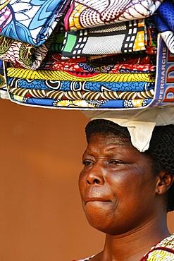 Street vendor selling African cloths, Lome, Togo, West Africa, Africa