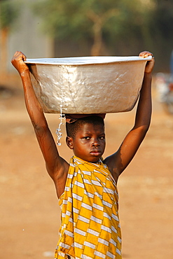 Water chore in an African village, Togo, West Africa, Africa
