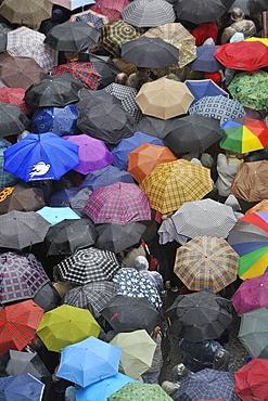 Pilgrims waiting in the rain for Pope Benedict XVI at Lourdes, Hautes Pyrenees, France, Europe