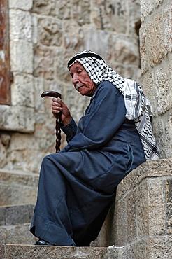 Old Palestinian man resting in East Jerusalem, Jerussalem, Israel, Middle East