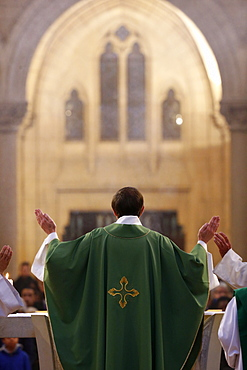 Eucharist, priest in Catholic Mass, Notre-Dame du Perpetuel Secours Basilica, Paris, France, Europe