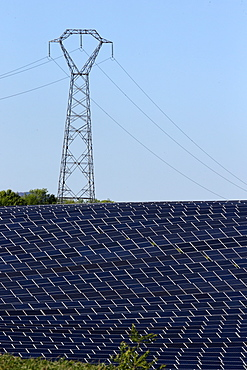 Solar farm, Photovoltaic power plant and pylon, Alpes-de-Haute-Provence, France, Europe