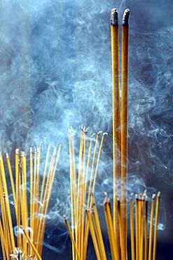 Incense sticks on joss stick pot burning and smoke used to pay respect to Buddha, Taoist temple, Phuoc An Hoi Quan Pagoda, Ho Chi Minh City, Vietnam, Indochina, Southeast Asia, Asia