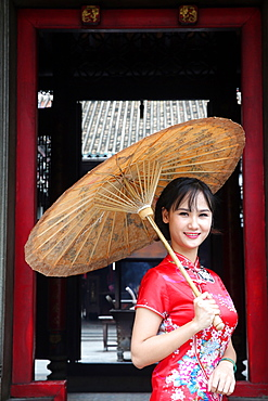 Woman wearing Vietnamese tradition dress called Ao Dai, Taoist temple, Phuoc An Hoi Quan Pagoda, Ho Chi Minh City, Vietnam, Indochina, Southeast Asia, Asia