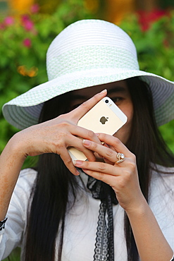 Woman taking picture with a smartphone, Vietnam, Indochina, Southeast Asia, Asia