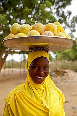 Young woman selling fruit in Koupela, Burkina Faso, Africa