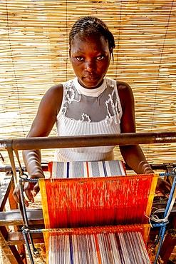 Young weaver in Koudougou, Burkina Faso, West Africa, Africa